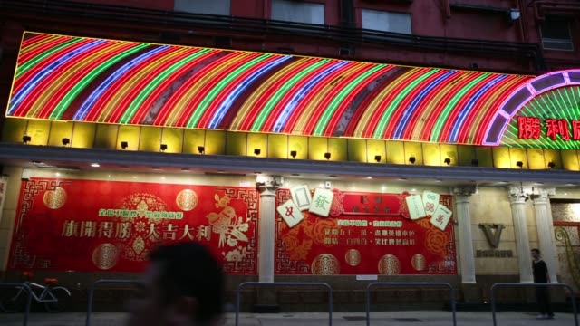 vídeos de stock, filmes e b-roll de illuminated neon signs are displayed in the kowloon district of hong kong, china, on monday, may 12, 2014 - kowloon