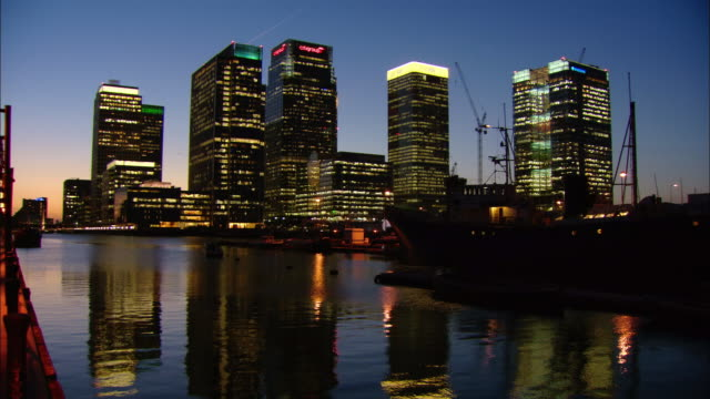 MS illuminated office buildings at dusk, London, England