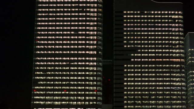cu, illuminated office buildings at night, yokohama, japan - 外壁点の映像素材/bロール