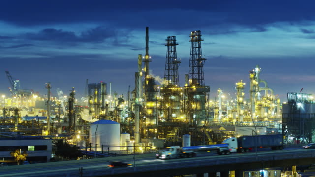 illuminated oil refinery - uav shot - oil refinery stock videos & royalty-free footage