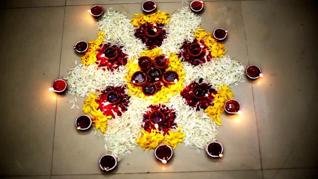 Illuminated Rangoli made by flower petals on Diwali festival