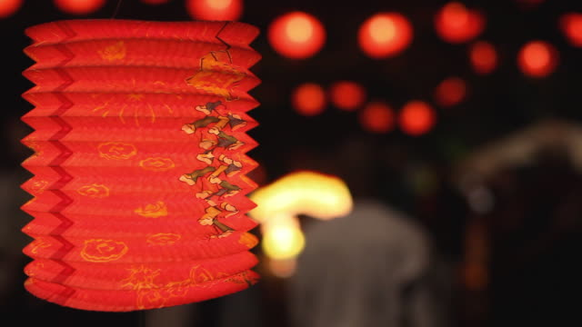 CU SELECTIVE FOCUS Illuminated red Chinese lantern hanging at Chinese New Year Lantern Festival, night / Auckland, New Zealand