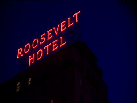 illuminated red rooftop sign on roosevelt hotel hollywood boulevard los angeles - hollywood boulevard stock videos and b-roll footage