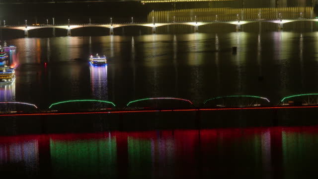 illuminated riverboat cruising at night on taedong river in pyongyang, north korea, dprk. medium wide time-lapse shot from above - spoonfilm stock videos and b-roll footage