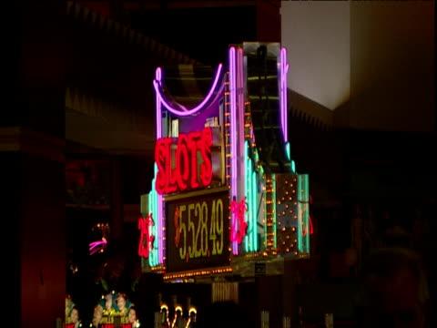 illuminated rotating sign advertises slot machine prize money in casino las vegas - casino stock videos & royalty-free footage