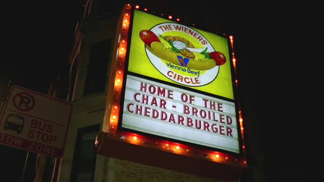 la illuminated sign for the wieners circle / chicago, illinois - hot dog stock videos & royalty-free footage