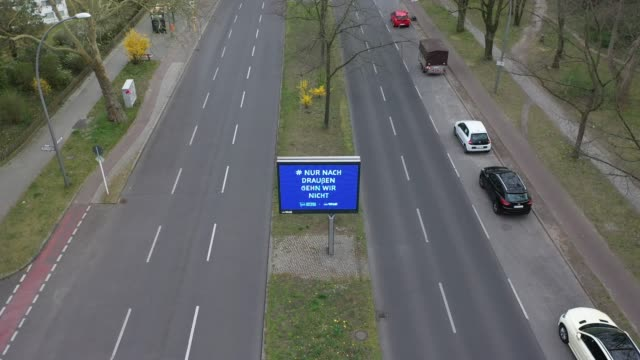 """illuminated sign with the inscription and hashtag and logo of the berlin football club hertha bsc: """"we just don't go outside"""" at a normally busy... - sign language stock videos & royalty-free footage"""
