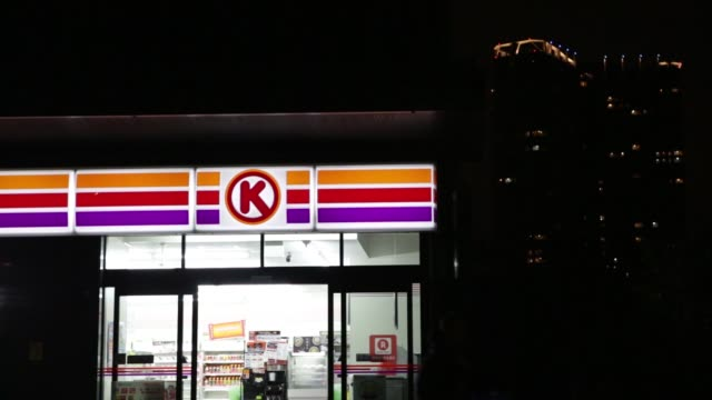 illuminated signage for circle k is displayed outside convenience store, operated by circle k sunkus co, a subsidiary of uny group holdings co, at... - ナイトイン点の映像素材/bロール