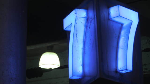 Illuminated signage indicates platform number seven at a railway station in Mumbai, Maharashtra, India.