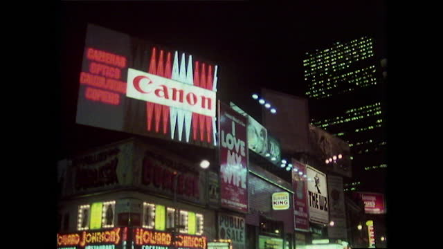 illuminated signs at night in times square, new york city; 1980 - film montage stock videos & royalty-free footage