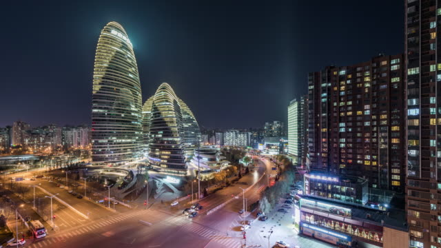 T/L HA Illuminated Skyscrapers (Wangjing Soho) and Grid Apartment at night / Beijing, China