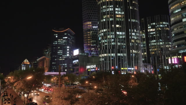 ws illuminated skyscrapers at night in sanlitun, beijing, china - geographical locations stock videos & royalty-free footage