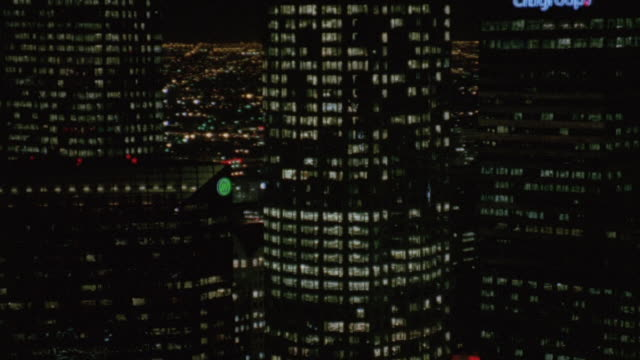 aerial illuminated skyscrapers downtown at night / los angeles, california, united states - 闊銀幕 個影片檔及 b 捲影像