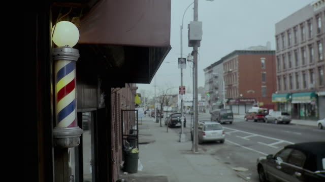 ms illuminated spinning light in front of  barber shop, brooklyn, new york city, new york state, usa - barber stock videos & royalty-free footage