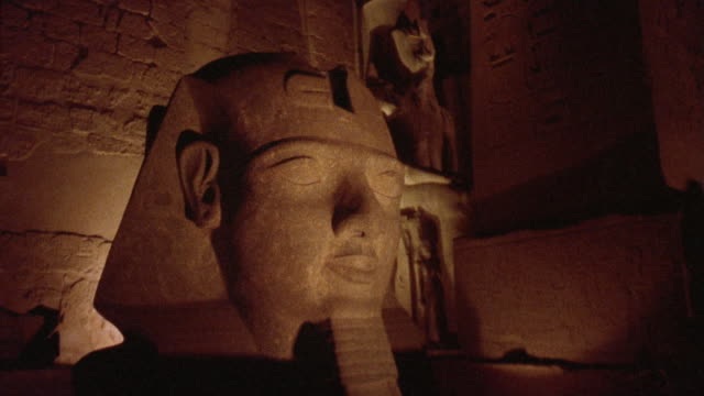cu illuminated statue of ramses ii at temple of luxor / thebes, egypt - luxor thebes stock videos & royalty-free footage