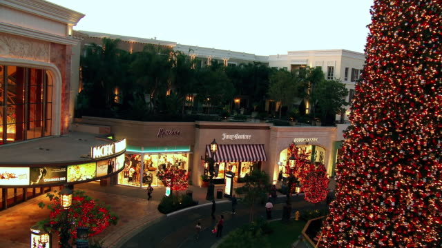 ws, ha, illuminated stores with christmas decorations at open air mall, glendale, california, usa - glendale california stock videos & royalty-free footage