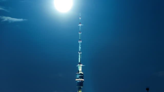 illuminated telecommunications tower in ostankino time lapse - telephoto lens stock videos and b-roll footage
