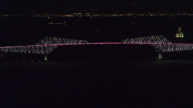 aerial, illuminated tokyo gate bridge, japan - tokyo bay stock videos & royalty-free footage