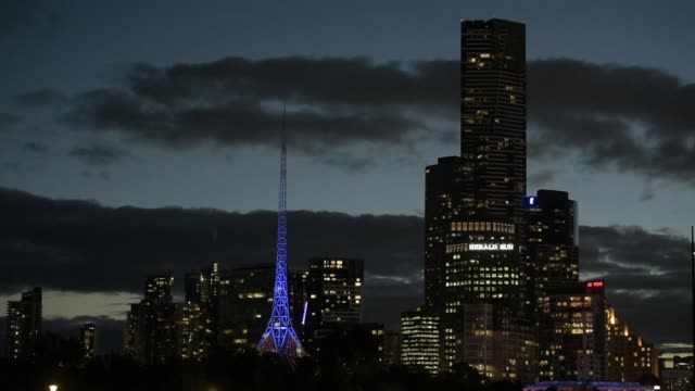 illuminated traffic move along a highway as commercial and residential buildings stand illuminated at dusk in melbourne australia on friday april 28... - general electric building stock videos and b-roll footage