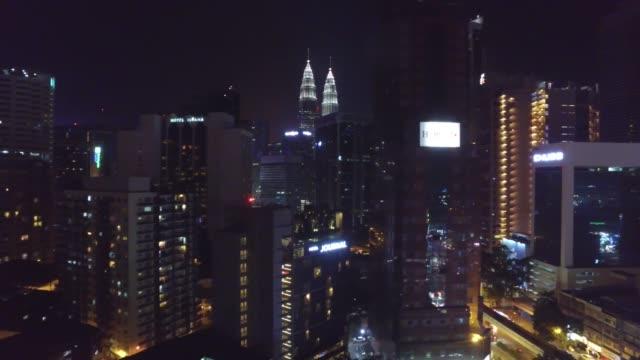 illuminated urban skyline of kuala lumpur, malaysia by night - menara kuala lumpur tower stock videos and b-roll footage