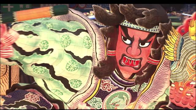 Illuminated warrior effigy spun around during Nebuta Festival