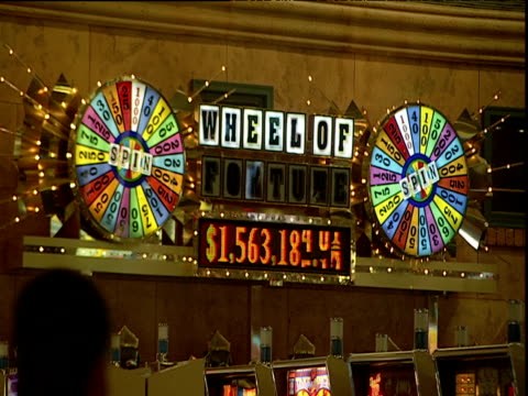 illuminated wheel of fortune sign in casino displays increasing prize money las vegas - casino stock videos & royalty-free footage