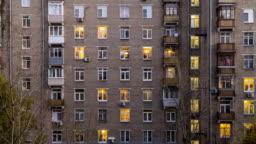 Illuminated windows of dwelling house time lapse