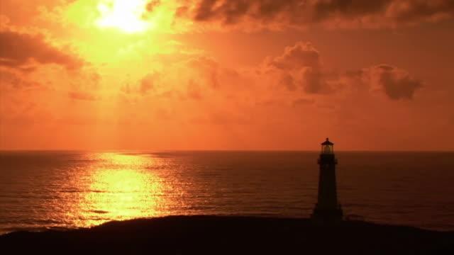 ws illuminated yaquina head lighthouse at sunset / newport, oregon, usa - newport oregon stock videos & royalty-free footage