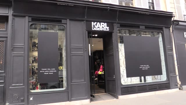 illustrations and hommage au karl lagarfeld boutique on 194 st germain boulevard in paris a message was put on the windows by the employees... - karl lagerfeld stock videos and b-roll footage