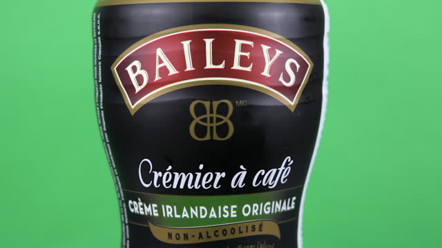 illustrative editorial clip of a bottle of coffee cream branded baileys seen on march 18, 2021 in toronto, ontario, canada. studio shot with a green... - chroma key stock videos & royalty-free footage