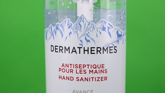 illustrative editorial clip of a dermathermes hand sanitizer bottle seen on march 18, 2021 in toronto, ontario, canada. studio shot with a green... - coloured background stock videos & royalty-free footage