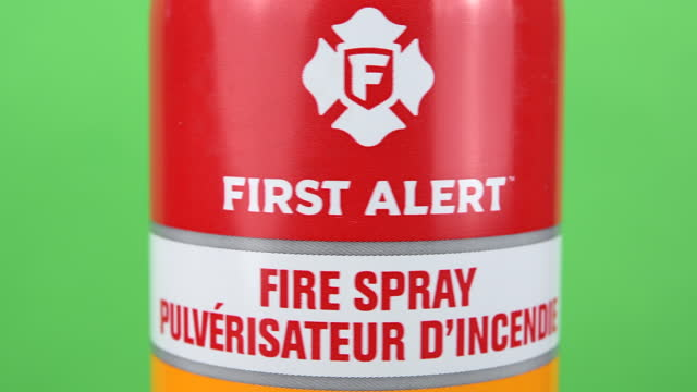 illustrative editorial clip of a fire spray branded first alert seen on march 18, 2021 in toronto, ontario, canada. studio shot with a green... - coloured background stock videos & royalty-free footage
