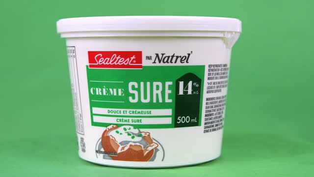 illustrative editorial clip of sour cream branded sealtest by natrel seen on march 18, 2021 in toronto, ontario, canada. studio shot with a green... - coloured background stock videos & royalty-free footage