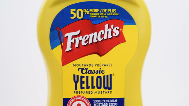 illustrative editorial of a plastic bottle of french's classic yellow mustard on march 18, 2021; in toronto, ontario canada, - white background stock videos & royalty-free footage