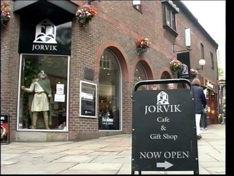 Image abroad York RAINING People along on narrow street DRY GV Jorvik Viking exhibition centre Peter Addyman interviewed SOT We have an alert which...