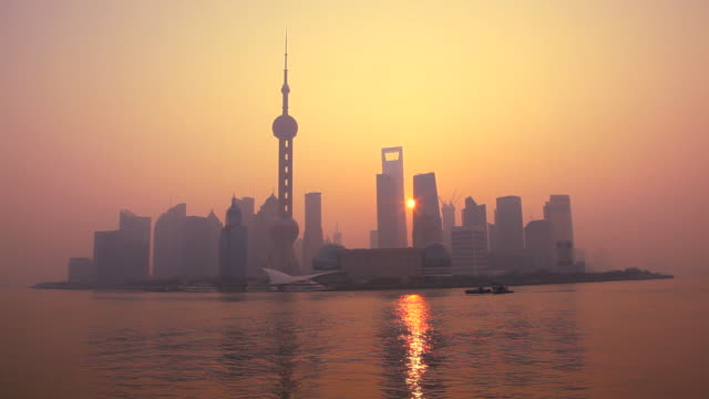 image at sunrise of modern shanghai city, oriental pearl tower, huangpu river, pudong district, shanghai, china, asia - the bund stock videos & royalty-free footage