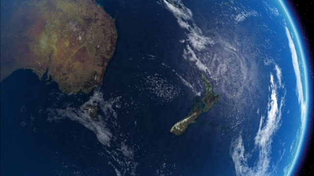 Image of earth revolving and zooms in to Snow covered South Island mountain ranges of New Zealand. Available in HD.