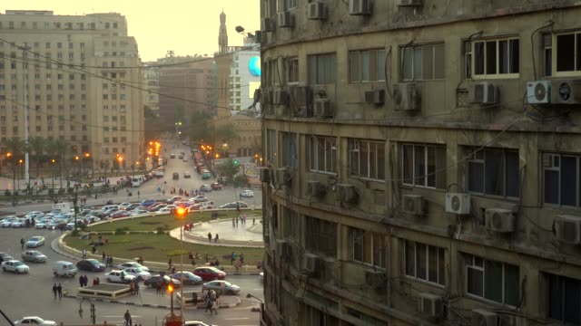 image of tahrir square from a window in cairo, egypt. - cairo stock videos & royalty-free footage