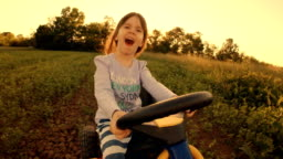 HD Image Sequence. GENDER NEUTRAL KIDS. A Happy Little Girl Drive Go-chart, Off-Road. Happy Memories Of Her Young Days