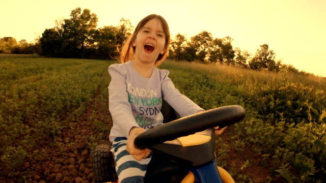 hd image sequence. gender neutral kids. a happy little girl drive go-chart, off-road. happy memories of her young days - potere femminile video stock e b–roll