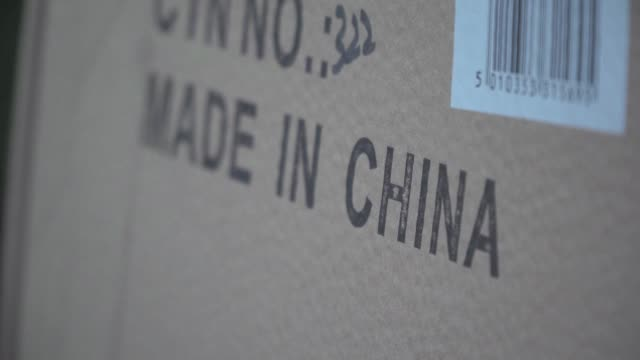 images depict made in china clothes and shoes in los angeles stores as us president donald trump confirms that an additional 15 percent tariff on... - tariff stock videos & royalty-free footage