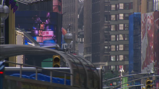 images flash across a jumbotron as traffic travels past stop lights. - large scale screen stock videos & royalty-free footage