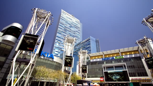 Images flash across giant LED screens in the Nokia Plaza in Los Angeles.