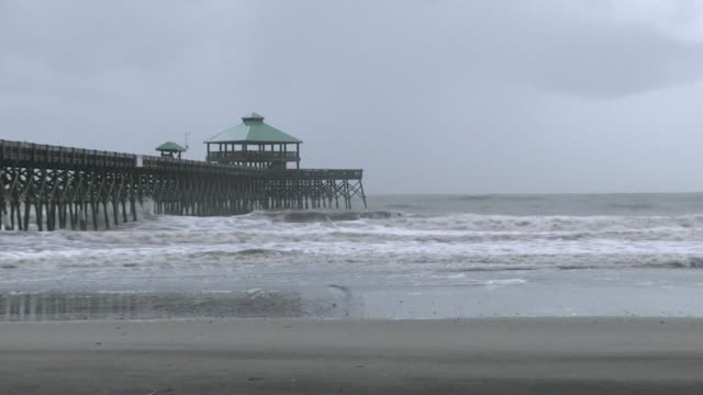 images from folly beach in south carolina show choppy waters and fog hanging over the seashore as hurricane dorian looms - carolina beach stock videos and b-roll footage
