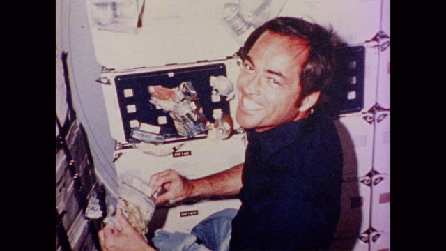 Images of astronauts Roger Crippen and John Young as they perform daily tasks in zero gravity