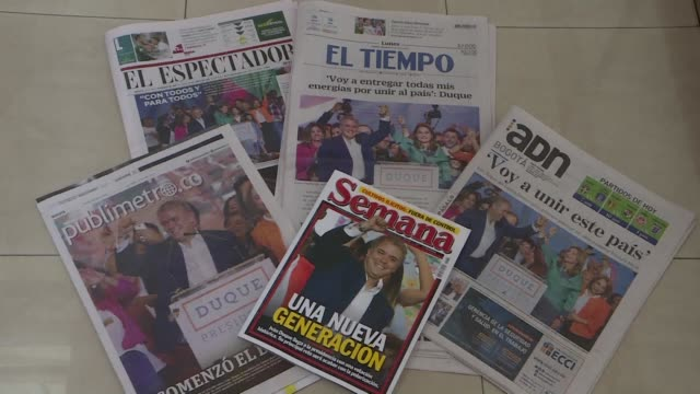 Images of newspaper headlines as Colombians in Bogota remain divided after the presidential elections which saw conservative Ivan Duque beat leftist...