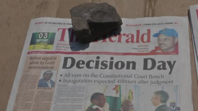 images of newspaper headlines in zimbabwe as the country's top court is set to rule on an opposition bid to have presidential election results thrown... - idrottsbana bildbanksvideor och videomaterial från bakom kulisserna