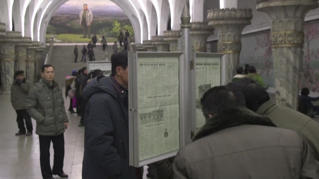 Images of residents of North Korean capital Pyongyang reading newspapers as Malaysian police said they have arrested a North Korean man over the...