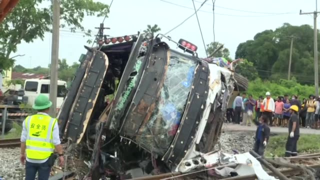 images of site where officials said at least 17 passengers were killed and more than a dozen injured on sunday when a bus collided with a train east... - dozen stock videos & royalty-free footage