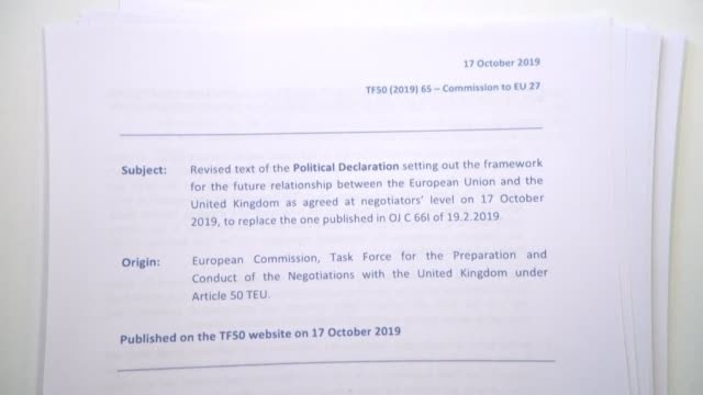images of the text of the agreement reached between the united kingdom and the european union just hours before an eu summit that may result in its... - adoption stock videos & royalty-free footage